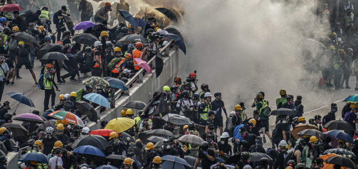 Hong Kong Police Force fire tear gas canisters at citizens protesting the controversial extradition bill.